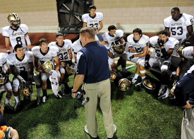 O'Connor head coach David Malesky talks to his defense on the bench during a district football game between the Warren Warriors and the o'Connor Panthers at Farris Stadium in San Antonio, Saturday, October 19, 2012.