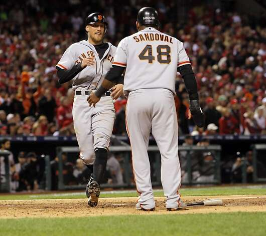 Hunter Pence is greeted by Pablo Sandoval at home after they both scored in the fourth inning on a single to center by Brandon Crawford. The San Francisco Giants played the St. Louis Cardinals in Game 5 of the National League Championship Series at Busch Stadium on Friday, October 19, 2012, in St. Louis, Mo. The Giants defeated the Cardinals 5-0 to stay alive in the series and head back to San Francisco for game 6. Photo: Carlos Avila Gonzalez, The Chronicle