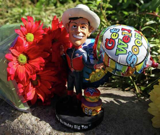 A Big Tex bobble head is pictured with flowery remembrances at the site of the Big Tex fire at the State Fair of Texas in Fair Park, on Friday, Oct. 19, 2012 in Dallas. Photo: Louis DeLuca, Dallas Morning News / Dallas Morning News
