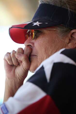 Jean Williams, 62, watches emotionally from a concession stand where she works as workers take Big Tex down after she watched the 60-year-old statue burn at the State Fair of Texas in Fair Park, on Friday, Oct. 19, 2012, in Dallas. Photo: Nathan Hunsinger, Dallas Morning News / Dallas Morning News