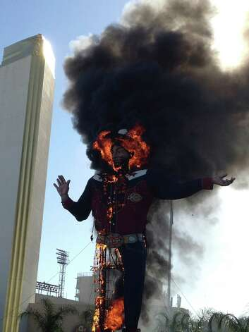 Fire engulfs the Big Tex cowboy statue displayed at the State Fair of Texas in Dallas on Friday, Oct. 19, 2012. The iconic structure caught fire and burned this morning. Photo: John McKibben, Associated Press