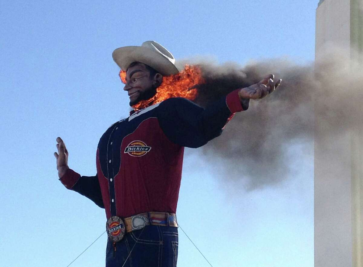 Fire begins to engulf the Big Tex displayed at the State Fair of Texas in Dallas Friday, Oct. 19, 2012. The iconic structure was destroyed Friday when flames engulfed his 52-foot-tall frame.