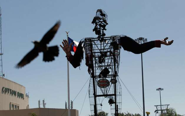The burned remains of Big Tex stand at the State Fair of Texas  Friday, Oct. 19, 2012, in Dallas. The iconic structure was destroyed Friday when flames engulfed his 52-foot-tall frame. Photo: LM Otero, Associated Press