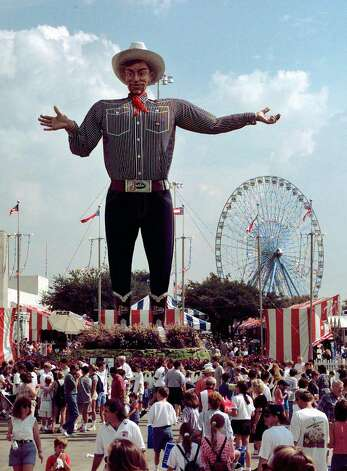 Big Tex watches over the crowd at one end of the State Fair of Texas midway Monday, Oct. 6, 1997, in Dallas. Several local school districts closed schools to allow students to attend the fair. Photo: Bill Janscha, Associated Press / AP1997