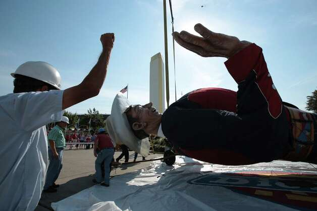 Workers raise Big Tex for his 60th time for the Texas State Fair at Fair Park in Dallas Sept. 24, 2012. Photo: Nathan Hunsinger, Dallas Morning News / 10015425A