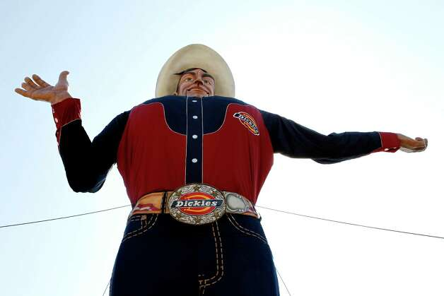 The 52-foot-tall cowboy known as Big Tex is made ready to welcome visitors to the State Fair of Texas after being lifted up to his familiar spot on Monday, Sept. 26, 2011, in Dallas. Photo: Lara Solt, Dallas Morning News / The Dallas Morning News