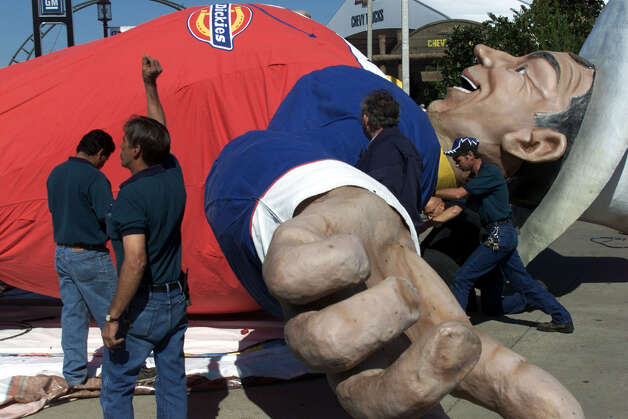 "Workers get Big Tex ready for display at the State Fair of Texas in Dallas, Monday, Sept. 24, 2001. The more-than-50-foot-tall figure sports a red, white and blue outfit and welcomes fairgoers with a booming ""Howdy."" Photo: Donna McWilliam, Associated Press / AP"