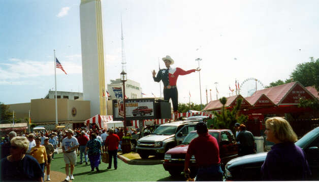 Big Tex, a 52-foot-high State Fair of Texas icon who turned 50 this year, towers above the midway at the in Dallas. October 2002. Photo: Terry Scott Bertling, San Antonio Express-News / SAN ANTONIO EXPRESS-NEWS