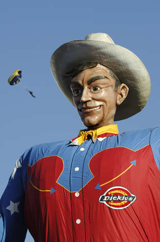 Big Tex is, indeed, big. The longtime symbol of the Texas State Fair, he's a popular meeting spot — even for parachutists. Photo: Photo By Kevin Brown, Courtesy Photo / Copyright 2006 Kevin Brown