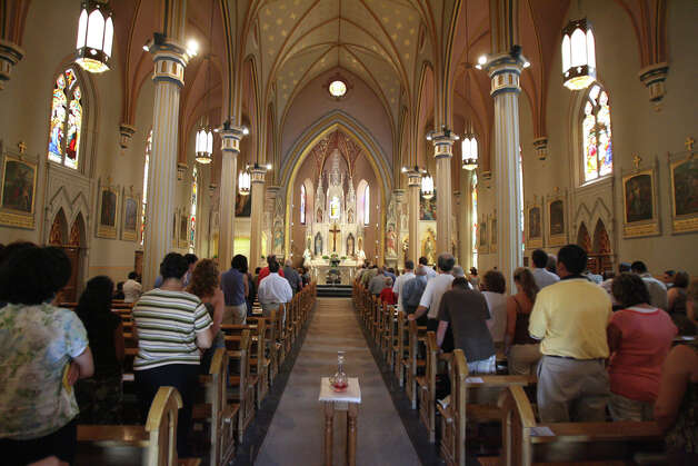 Parishioners at St. Joseph's Catholic Church. File photo / San Antonio Express-News