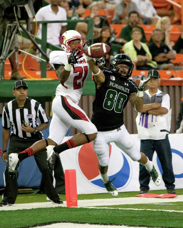 Hawaii wide receiver Jeremiah Ostrowski can't pull a pass in over Lamar defensive back Branden Thomas during the third quarter of the NCAA game between the Lamar and Hawaii, Sept. 15, 2012 in Honolulu.  (AP Photo/Marco Garcia) Photo: Marco Garcia, FRE / FR132415 AP