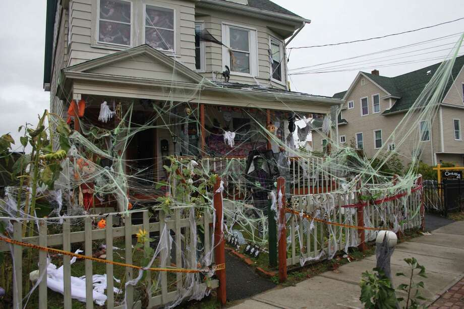 Nivia Ruiz has been busy getting ready for Halloween, spending about 5 hours a day decorating her Connecticut Ave. house to make sure trick-or-treaters have fun on Halloween night. Photo: Jeff Bustraan / Connecticut Post