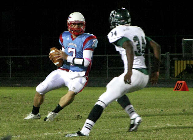 Quarterback Drew Manley runs an option play as the Lumberton Raiders were defeated by the Livingston Lions 55-14. Photo: David Lisenby, Freelance