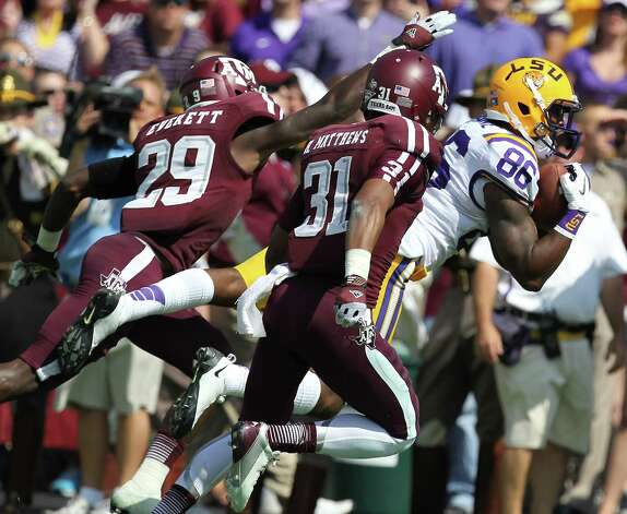 LSU 24, Texas A&M 19LSU receiver Kadron Boone (86) gets behind Texas A&M defenders Deshazor Everett (29) and Howard Matthews for a touchdown during the end of the second quarter of a NCAA football game, Saturday, Oct. 20, 2012, in College Station. Photo: Nick De La Torre, Houston Chronicle / © 2012  Houston Chronicle