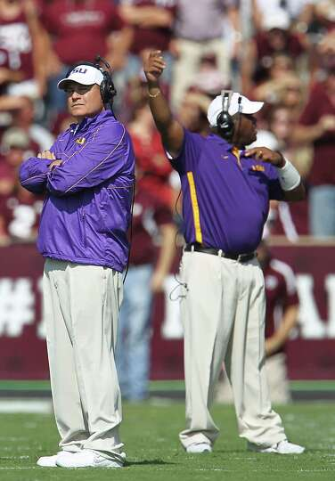 LSU's coach Les Miles on the field during the first half of a college football game at Kyle Stadium,
