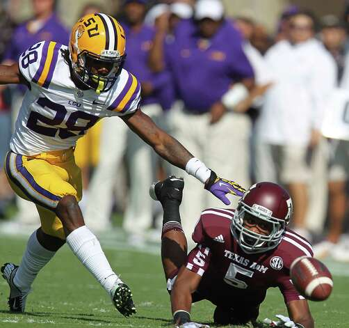 Texas A&M's Kenric McNeal (5) just misses the pass as he was covered by LSU's Jalen Mills (28) during the first half of a college football game at Kyle Stadium, Saturday, Oct. 20, 2012, in College Station. Photo: Karen Warren, Houston Chronicle / © 2012  Houston Chronicle