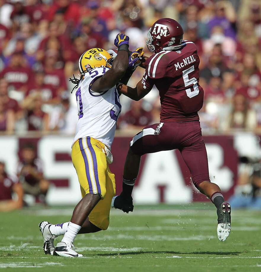 A&M's Kenric McNeal (5) tries to get his hands on pass as LSU's Lamin Barrow (57) defends during the first half of a college football game at Kyle Stadium, Saturday, Oct. 20, 2012, in College Station. Photo: Karen Warren, Houston Chronicle / © 2012  Houston Chronicle