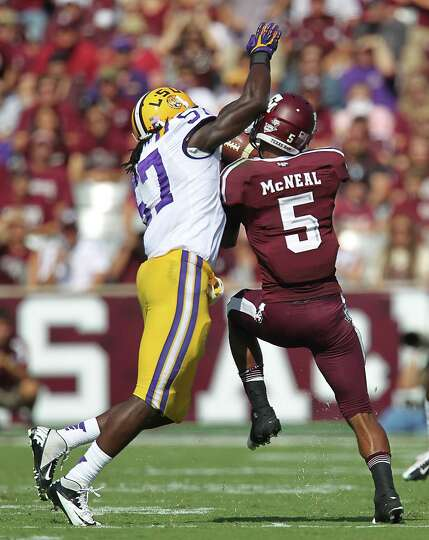 A&M's Kenric McNeal (5) tries to get his hands on pass as LSU's Lamin Barrow (57) defends during the