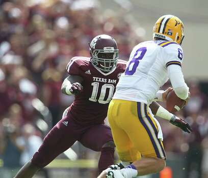 LSU's QB Zach Mettenberger (8) is sacked by A&M's Sean Porter (10) during the first half of a college football game at Kyle Stadium, Saturday, Oct. 20, 2012, in College Station. Photo: Karen Warren, Houston Chronicle / © 2012  Houston Chronicle