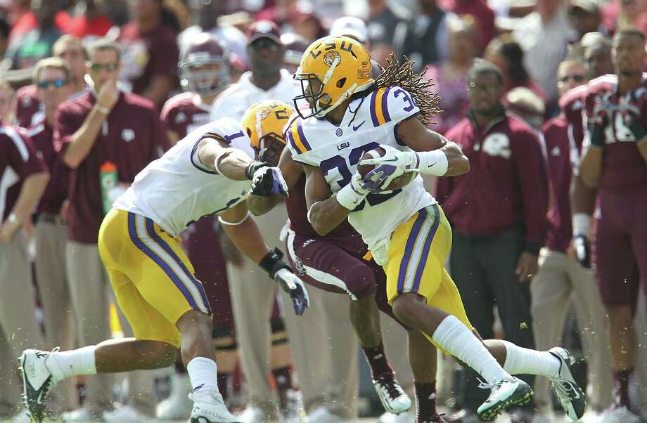 LSU's Jalen Collins intercepts the ball for the turnover during the first half of a college football game at Kyle Stadium, Saturday, Oct. 20, 2012, in College Station. Photo: Karen Warren, Houston Chronicle / © 2012  Houston Chronicle