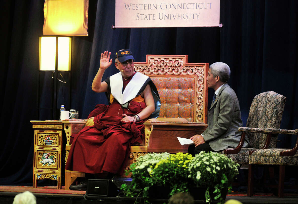 """The Dalai Lama, left, makes a point after giving his """"Advice for Daily Life"""" speech with the help of his translator, Thupten Jinpa, at the O'Neill Center at Western Connecticut State University in Danbury on Friday, Oct. 19, 2012."""