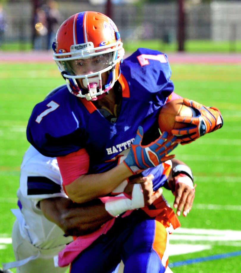 Corey Chaffee carries the ball as Danbury High School plays Westhill High School at Danbury Saturday, Oct. 20, 2012. Photo: Michael Duffy / The News-Times