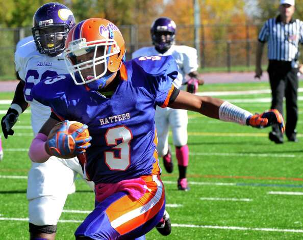 Corey Acosta carries the ball for a touchdown as Danbury High School plays Westhill High School at Danbury Saturday, Oct. 20, 2012. Photo: Michael Duffy / The News-Times