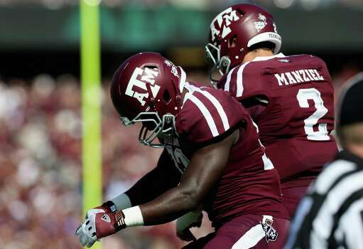 Christine Michael (33) and Johnny Manziel (2) of the Texas A&M Aggies celebrate a touchdown against the LSU Tigers at Kyle Field on October 20, 2012 in College Station, Texas. Photo: Ronald Martinez, Getty Images / 2012 Getty Images
