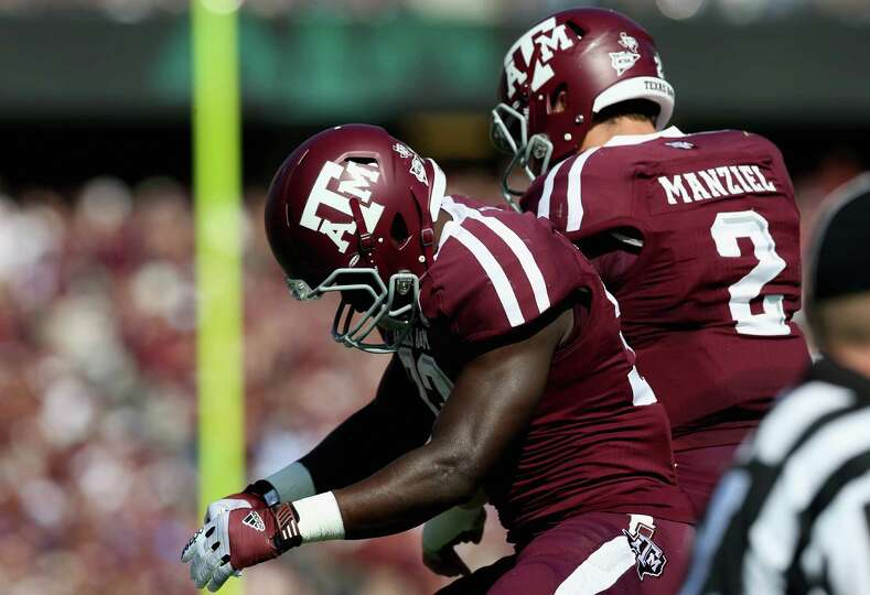 Christine Michael (33) and Johnny Manziel (2) of the Texas A&M Aggies celebrate a touchdown against