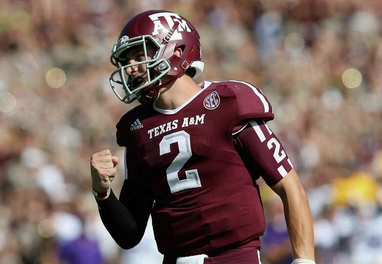 Johnny Manziel of the Texas A&M Aggies celebrates a touchdown against the LSU Tigers at Kyle Field o