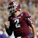 Johnny Manziel of the Texas A&M Aggies celebrates a touchdown against the LSU Tigers at Kyle Field on October 20, 2012 in College Station, Texas.
