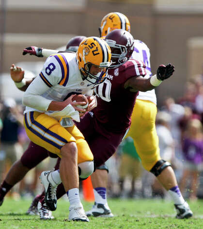 LSU quarterback Zach Mettenberger (8) is sacked by Texas A&M linebacker Sean Porter (10) during the first half of an NCAA college football game, Saturday, Oct. 20, 2012, in College Station, Texas. (AP Photo/Eric Kayne) Photo: Eric Kayne, Associated Press / FR170049 AP