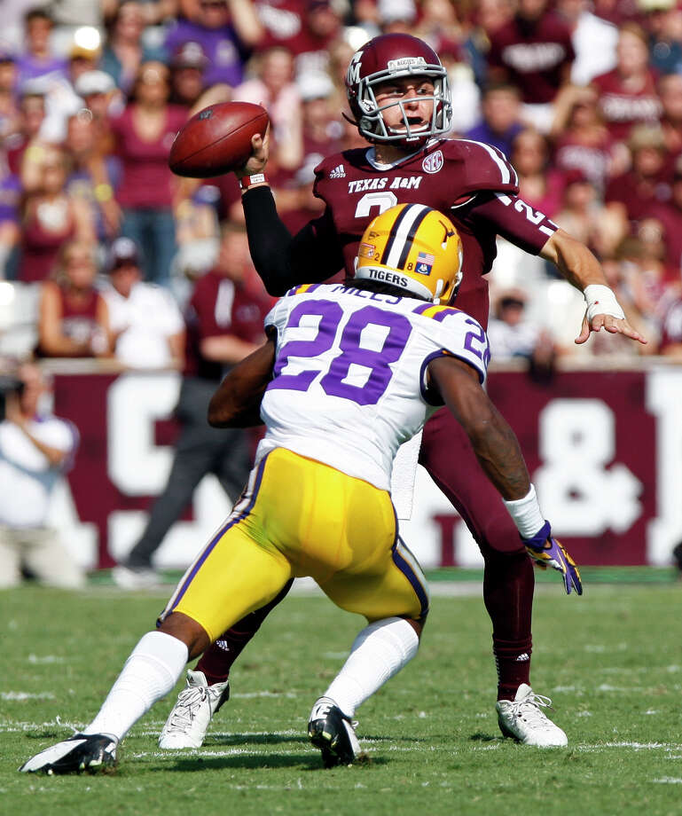 Texas A&M quarterback Johnny Manziel (2) throws under pressure from LSU cornerback Jalen Mills (28) during the first half of an NCAA college football game, Saturday, Oct. 20, 2012, in College Station, Texas. (AP Photo/Eric Kayne) Photo: Eric Kayne, Associated Press / FR170049 AP