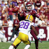 Texas A&M quarterback Johnny Manziel (2) throws under pressure from LSU cornerback Jalen Mills (28) during the first half of an NCAA college football game, Saturday, Oct. 20, 2012, in College Station, Texas. (AP Photo/Eric Kayne)