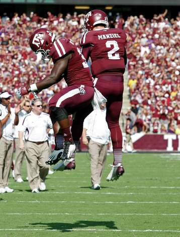 Texas A&M running back Christine Michael (33) and quarterback Johnny Manziel (2) celebrate a touchdown during the first half of an NCAA college football game against LSU, Saturday, Oct. 20, 2012, in College Station, Texas. (AP Photo/Eric Kayne) Photo: Eric Kayne, Associated Press / FR170049 AP