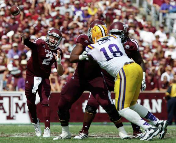 Texas A&M quarterback Johnny Manziel (2) throws against LSU during the second half of an NCAA college football game, Saturday, Oct. 20, 2012, in College Station, Texas. LSU won 24-19. (AP Photo/Eric Kayne) Photo: Eric Kayne, Associated Press / FR170049 AP