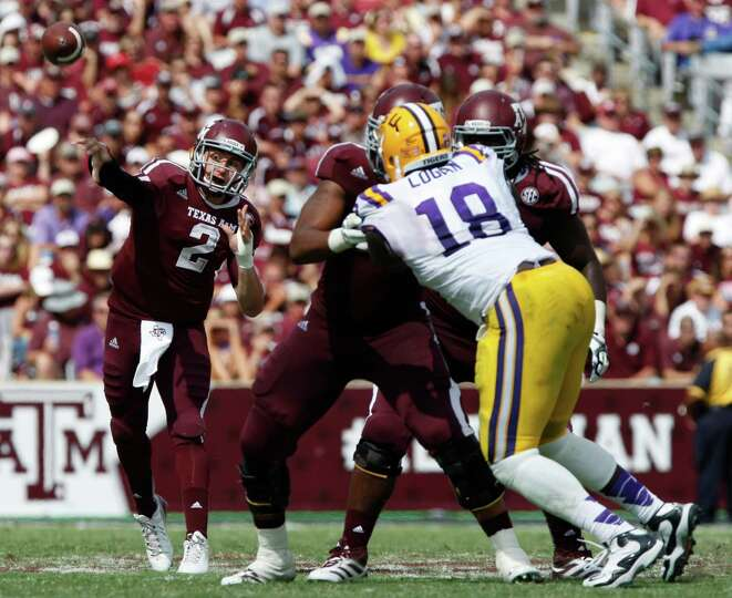 Texas A&M quarterback Johnny Manziel (2) throws against LSU during the second half of an NCAA colleg