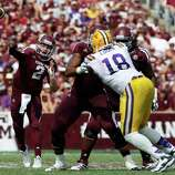 Texas A&M quarterback Johnny Manziel (2) throws against LSU during the second half of an NCAA college football game, Saturday, Oct. 20, 2012, in College Station, Texas. LSU won 24-19. (AP Photo/Eric Kayne)