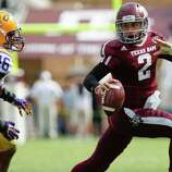 Texas A&M quarterback Johnny Manziel (2) runs from LSU linebacker Kevin Minter (46) during the second half of an NCAA college football game, Saturday, Oct. 20, 2012, in College Station, Texas. LSU won 24-19. (AP Photo/Eric Kayne)