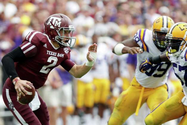 Texas A&M quarterback Johnny Manziel (2) looks for a receiver under pressure from LSU during the second half of an NCAA college football game, Saturday, Oct. 20, 2012, in College Station, Texas. LSU won 24-19. (AP Photo/Eric Kayne) Photo: Eric Kayne, Associated Press / FR170049 AP