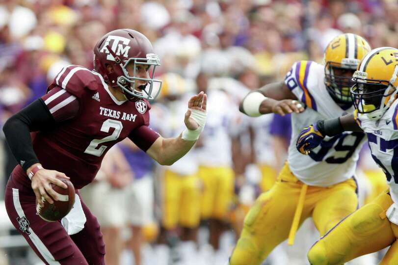 Texas A&M quarterback Johnny Manziel (2) looks for a receiver under pressure from LSU during the sec