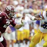 Texas A&M quarterback Johnny Manziel (2) looks for a receiver under pressure from LSU during the second half of an NCAA college football game, Saturday, Oct. 20, 2012, in College Station, Texas. LSU won 24-19. (AP Photo/Eric Kayne)