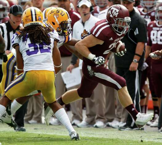 Texas A&M wide receiver Ryan Swope (25) runs against LSU defenders, including Jalen Collins, during the second half of an NCAA college football game, Saturday, Oct. 20, 2012, in College Station, Texas. LSU won 24-19. (AP Photo/Eric Kayne) Photo: Eric Kayne, Associated Press / FR170049 AP