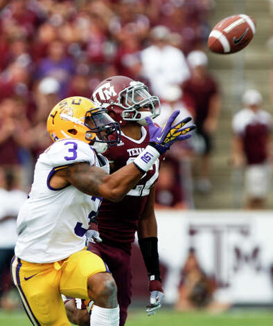 LSU wide receiver Odell Beckham Jr. (3) and Texas A&M defensive back Dustin Harris (22) battle for a pass during the second half of an NCAA college football game, Saturday, Oct. 20, 2012, in College Station, Texas. The pass fell incomplete. LSU won 24-19. (AP Photo/Eric Kayne) Photo: Eric Kayne, Associated Press / FR170049 AP