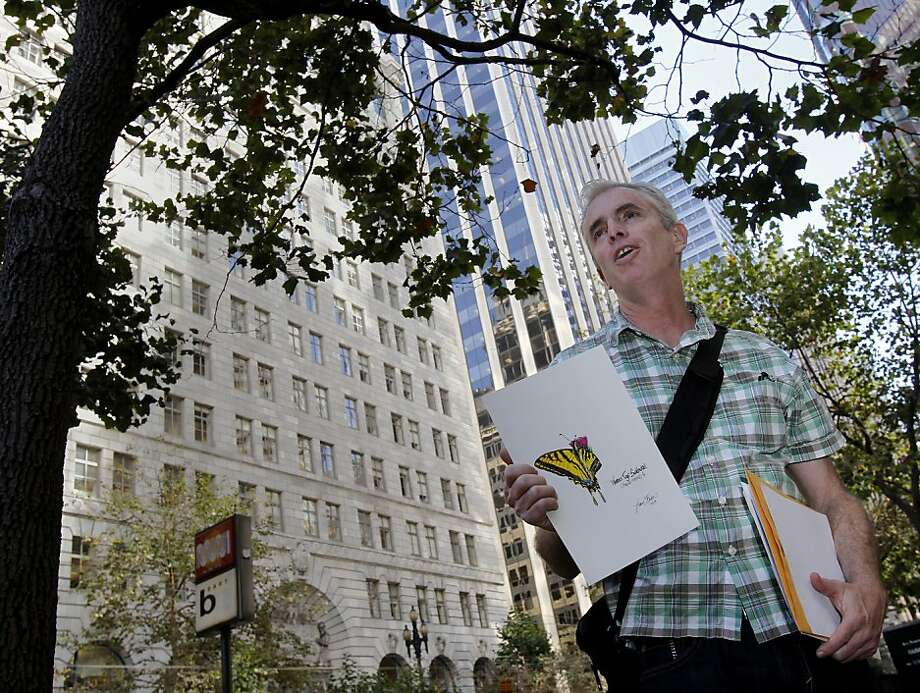 Urban butterfly expert Liam O'Brien discusses the Western tiger swallowtail, which thrives on S.F.'s Market Street but may lose its habitat if London plane trees are removed to make way for a bike lane. Photo: Brant Ward, The Chronicle