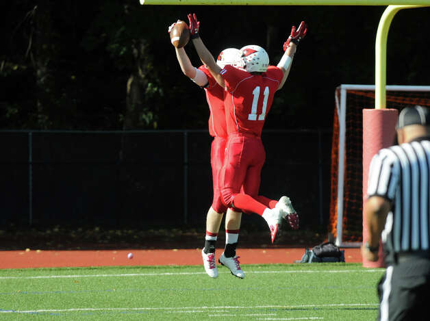 Greenwich's Joe Kelly, left, and Alex McMurray celebrate Kelly's touchdown as Greenwich High School hosts Bridgeport Central in a football game in Greeniwch, Conn., Oct. 20, 2012. Photo: Keelin Daly / Stamford Advocate Freelance