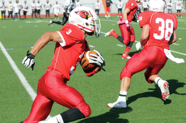 Greenwich's Austin Longi moves the ball as Greenwich High School hosts Bridgeport Central in a football game in Greeniwch, Conn., Oct. 20, 2012. Photo: Keelin Daly / Stamford Advocate Freelance