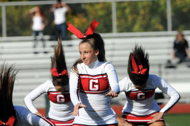 GHS cheerleaders perform during the half time show as Greenwich High School hosts Bridgeport Central in a football game in Greeniwch, Conn., Oct. 20, 2012. Photo: Keelin Daly / Stamford Advocate Freelance