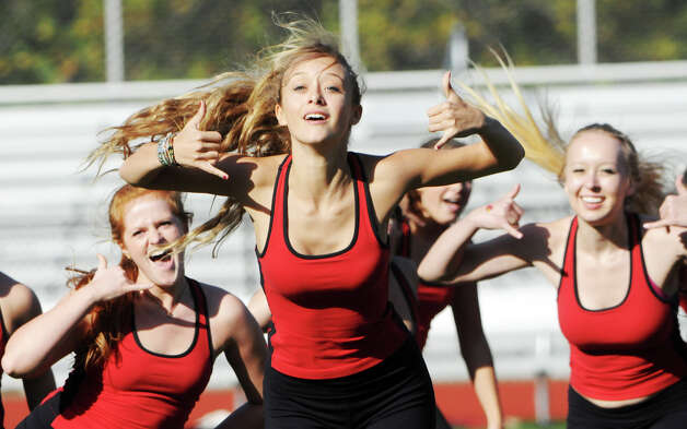 GHS dance team's Anna Zervos, center, performs with the team during the half time show as Greenwich High School hosts Bridgeport Central in a football game in Greeniwch, Conn., Oct. 20, 2012. Photo: Keelin Daly / Stamford Advocate Freelance