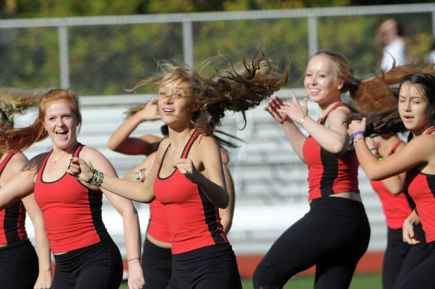 GHS dance team's Anna Zervos performs during the half time show as Greenwich High School hosts Bridgeport Central in a football game in Greeniwch, Conn., Oct. 20, 2012. Photo: Keelin Daly / Stamford Advocate Freelance